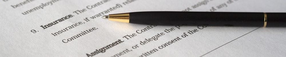 A pen lying on a contract.
